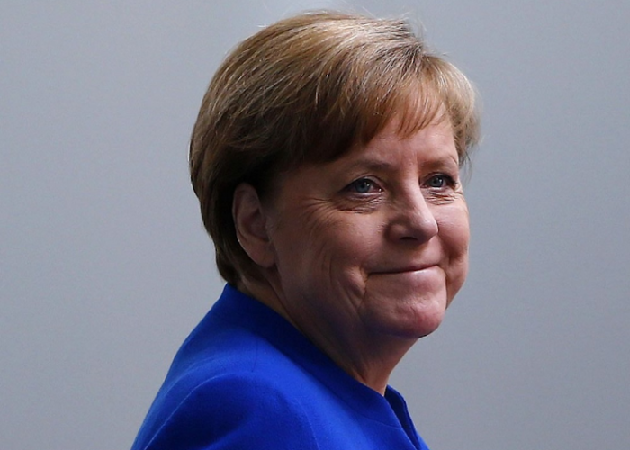 EU budget chief says Merkel should serve out term