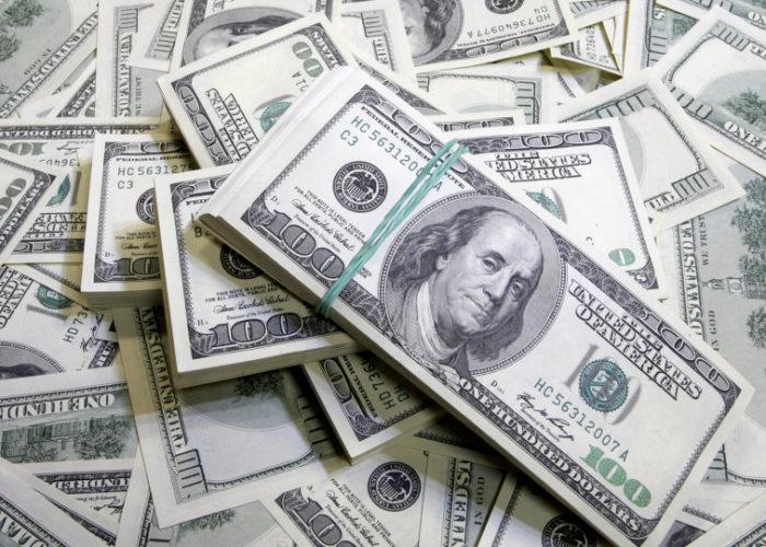 Dollar edges up as more central banks turn dovish