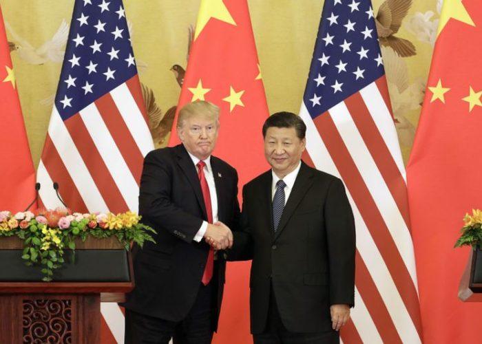 Dollar crawls higher as markets brace for Trump-Xi meeting